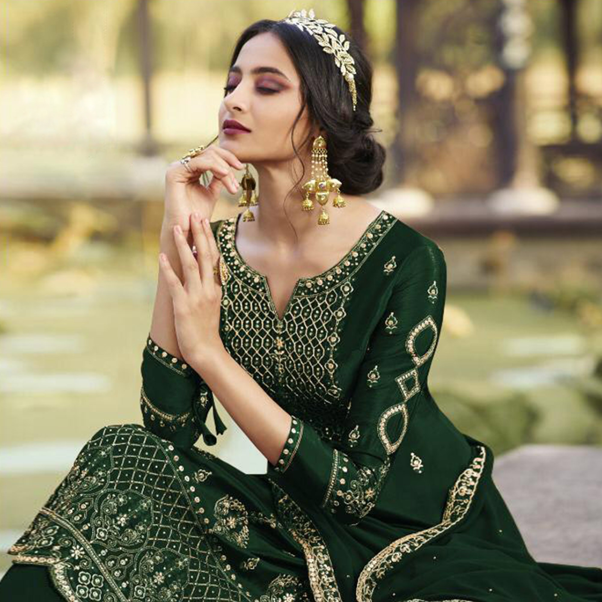 Gorgeous Green Colored Partywear Embroidered Heavy Faux Georgette Palazzo Suit