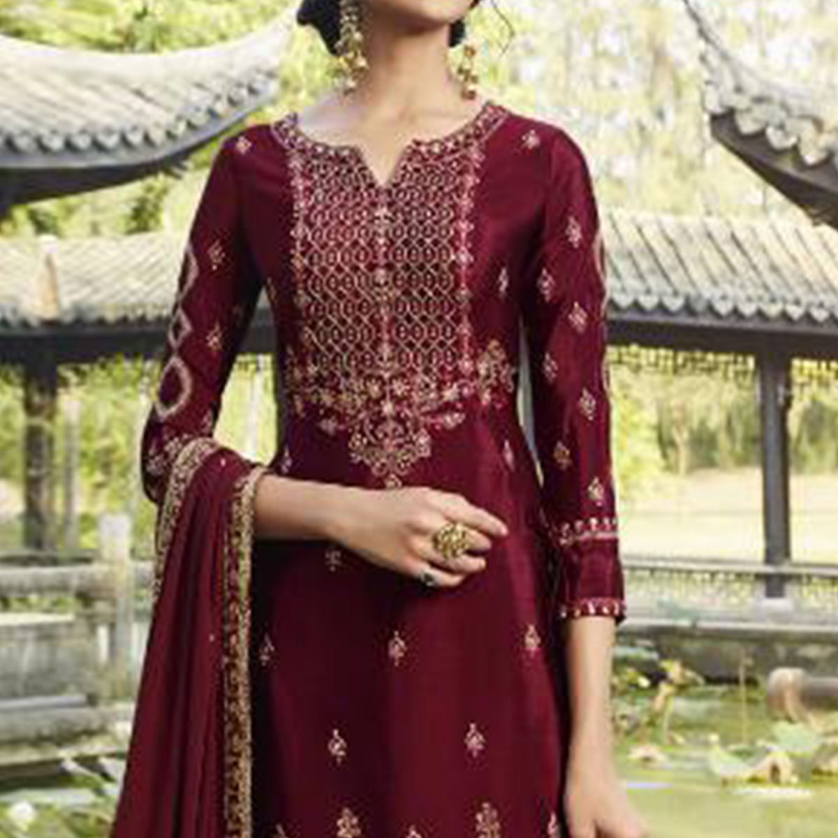 Imposing Red Colored Partywear Embroidered Heavy Faux Georgette Palazzo Suit
