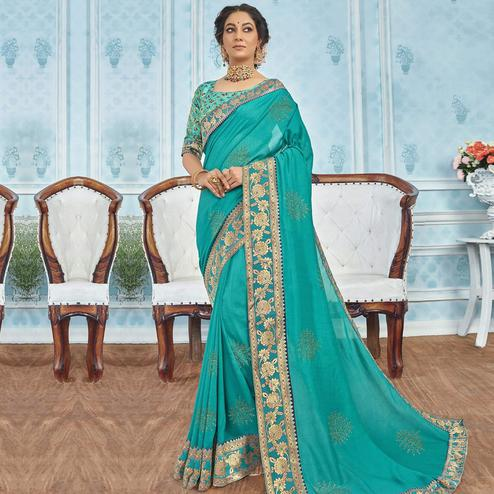 Captivating Turquoise Colored Party Wear Embroidered Georgette Saree
