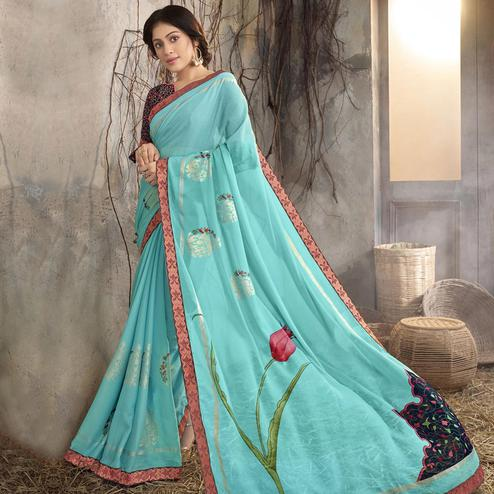 Radiant Sky Blue Colored Party Wear Printed Georgette Saree