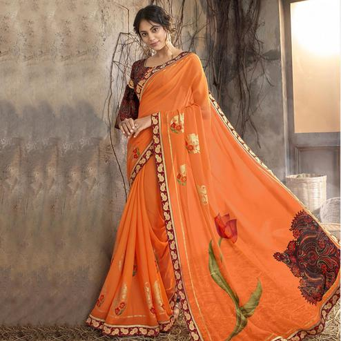 Pleasant Orange Colored Party Wear Printed Georgette Saree