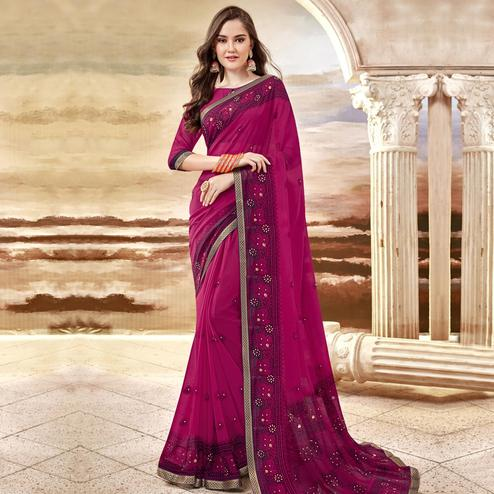 Intricate Pink Colored Party Wear Printed Georgette Saree
