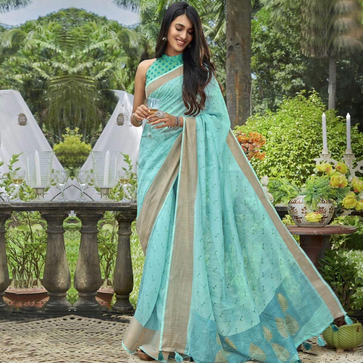 Surpassing Blue Colored Festive Wear Printed Cotton Saree With Tassels