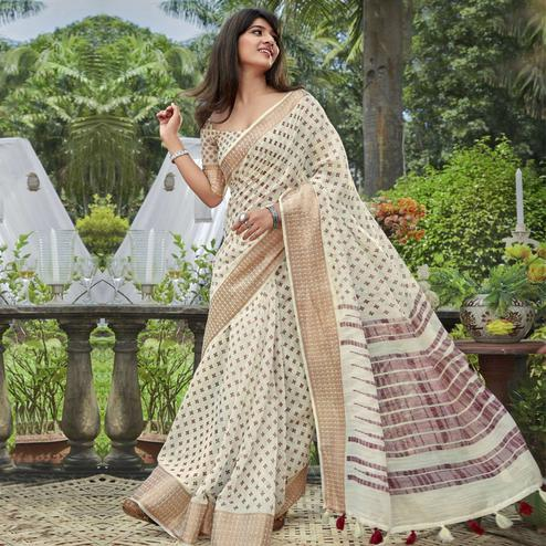 Prominent Cream Colored Festive Wear Printed Cotton Saree With Tassels