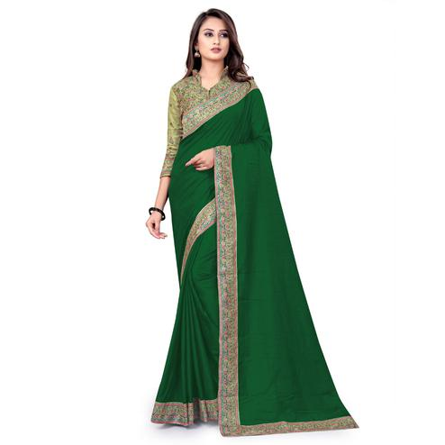 IRIS - Green Colored Party Wear Woven Dola Silk Saree