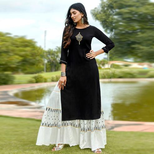 Mesmeric Black Colored Partywear Embroidered Rayon Sharara Suit