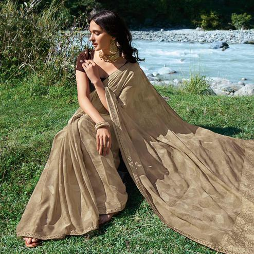 Hypnotic Beige Colored Partywear Foil Printed Chiffon Georgette Saree