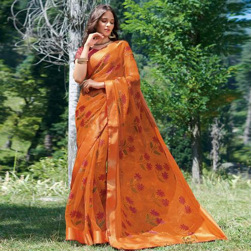 Flattering Orange Colored Partywear Printed Brasso Saree