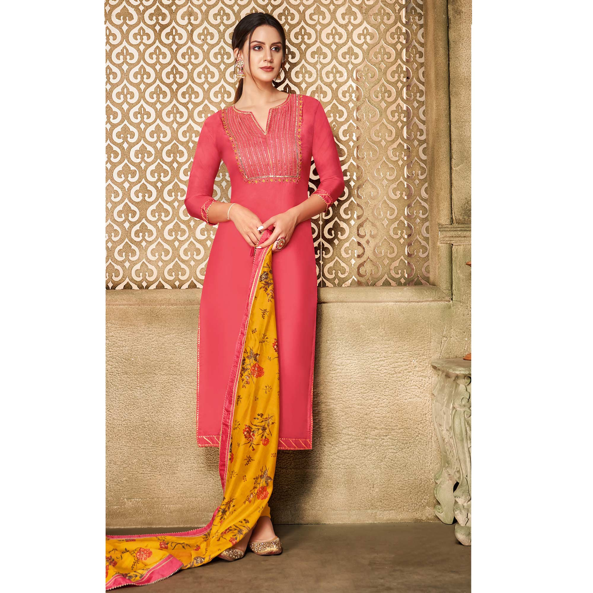 Gleaming Peach Colored Partywear Embroidered Chanderi Dress Material