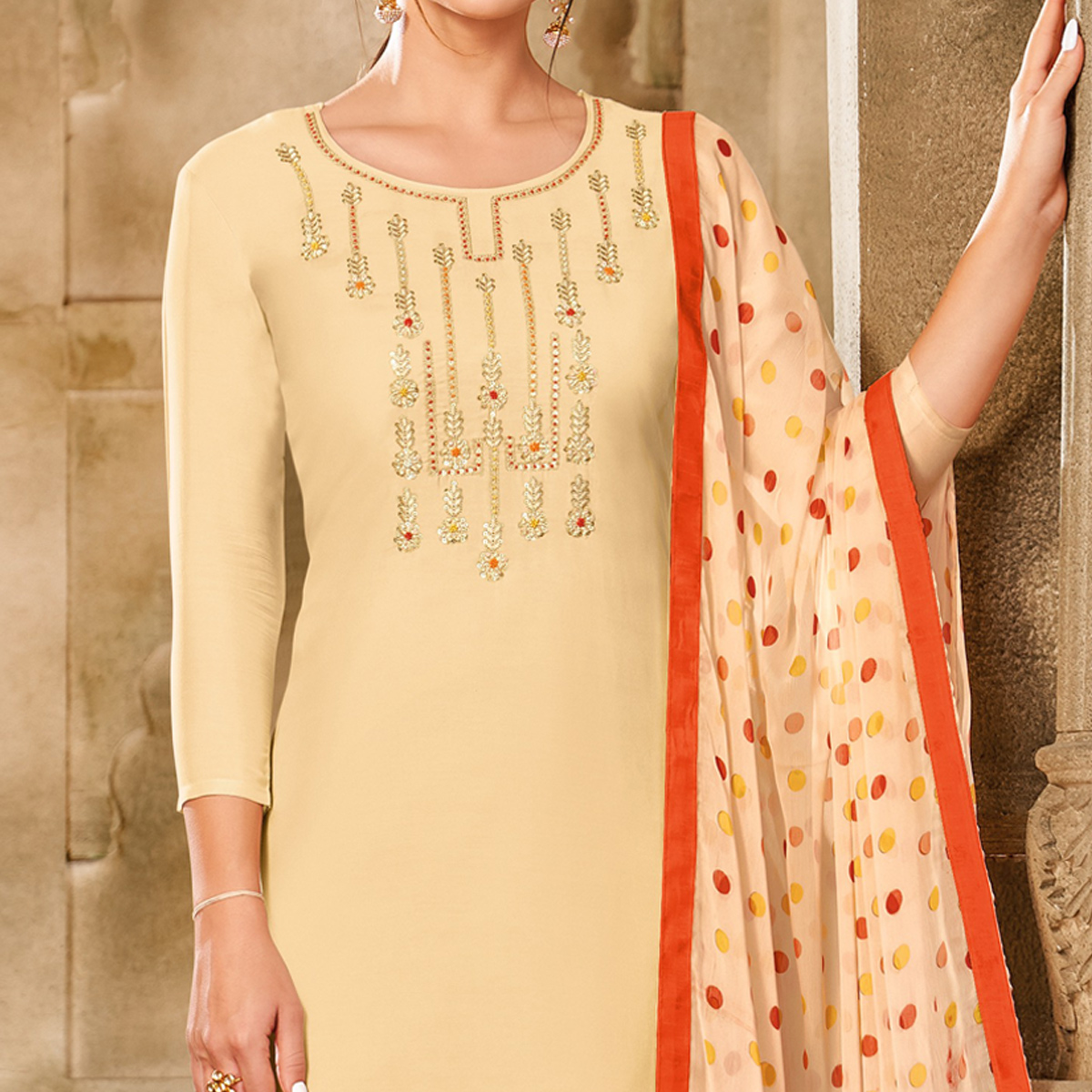 Mesmeric Cream Colored Partywear Embroidered Chanderi Dress Material