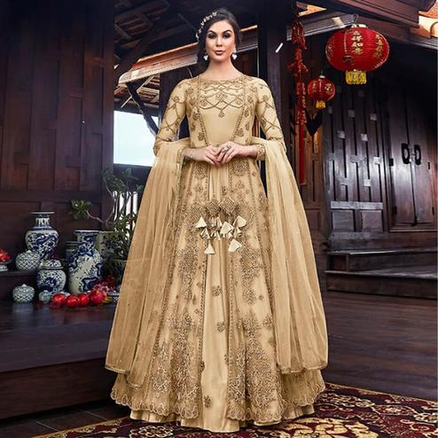 Attractive Light Yellow Colored Partywear Embroidered Net Palazzo Suit