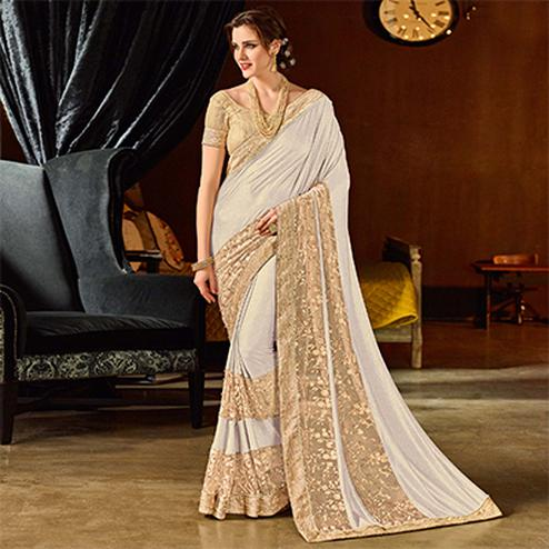 Classy Off-White Colored Designer Embroidered Jacquard Saree
