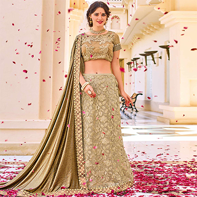 Gorgeous Golden Colored Designer Embroidered Lycra And Net Lehenga Saree