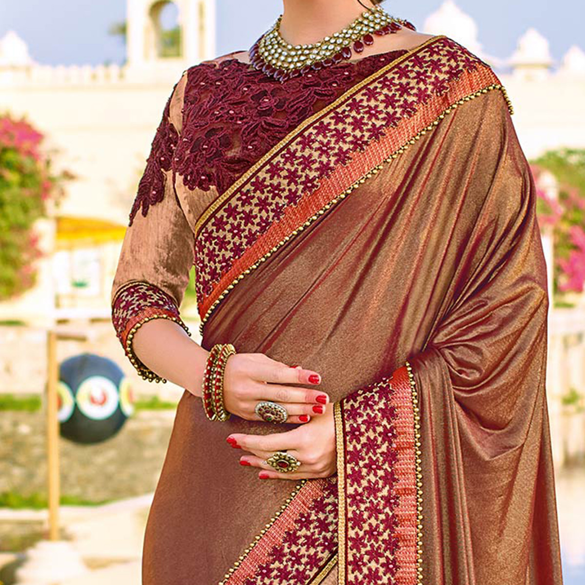 Graceful Maroon Colored Designer Embroidered Lycra And Net Saree
