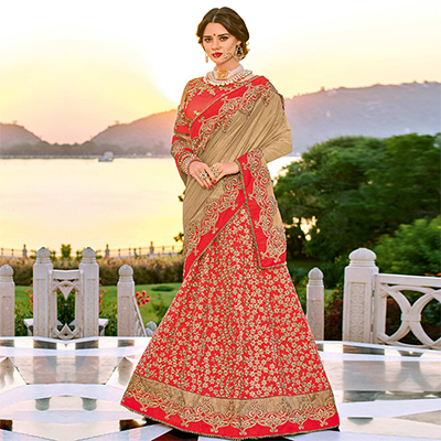 Beautiful Beige And Orange Colored Designer Embroidered Lycra And Silk Lehanga Saree