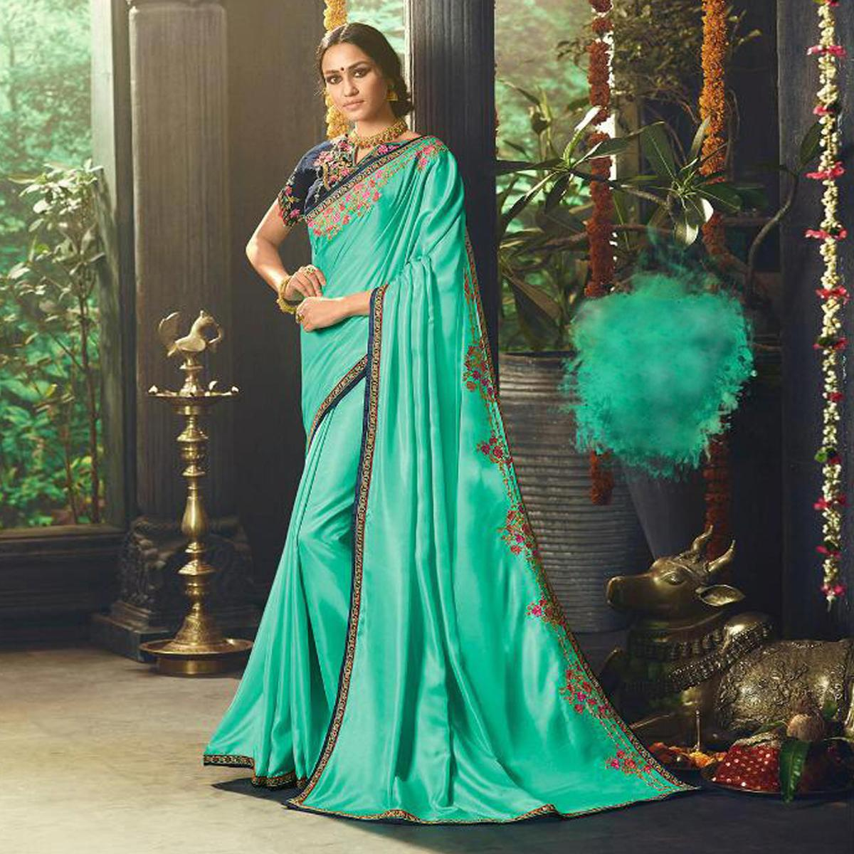 Prominent Rama Green Colored Partywear Embroidered Satin Saree