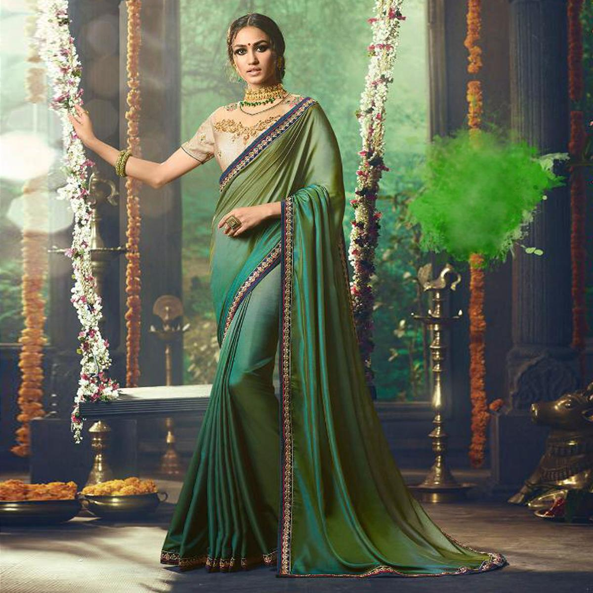 Entrancing Peacock Green Colored Partywear Embroidered Silk Saree