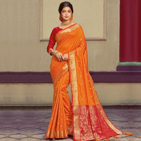 Magnetic Orange Colored Festive Wear Woven Handloom Silk Saree With Tassels