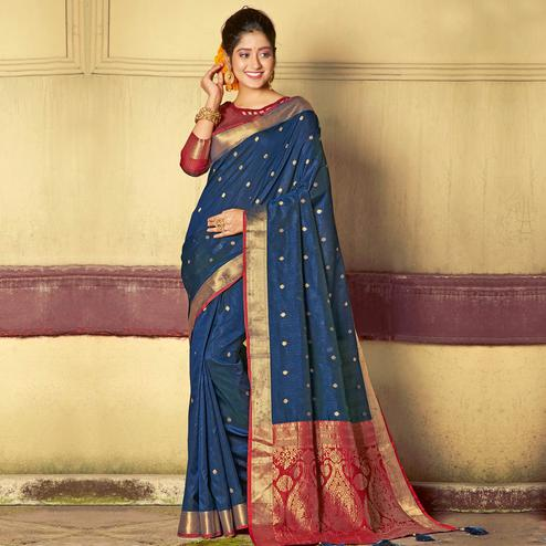 Marvellous Navy Blue Colored Festive Wear Woven Handloom Silk Saree With Tassels