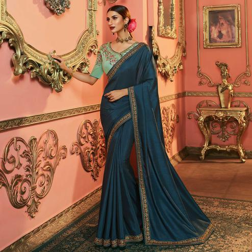 Mesmeric Teal Blue Colored Partywear Embroidered Dola Silk Saree
