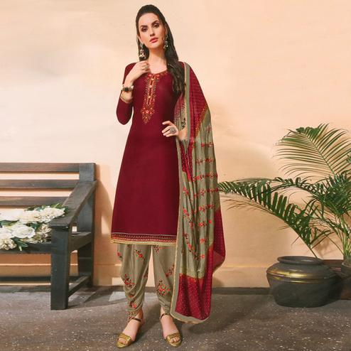 Staring Maroon Colored Partywear Embroidered Jam Satin Suit