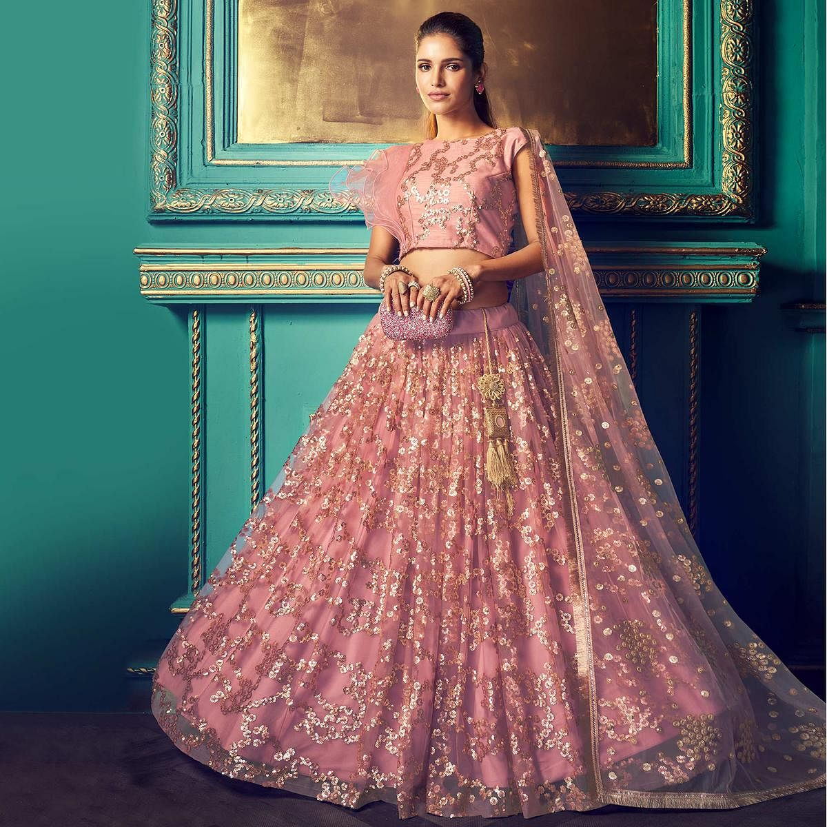 Impressive Purple Colored Partywear Embroidered Soft Net Lehenga Choli