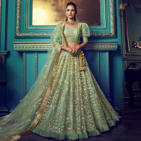 Staring Green Colored Partywear Embroidered Soft Net Lehenga Choli
