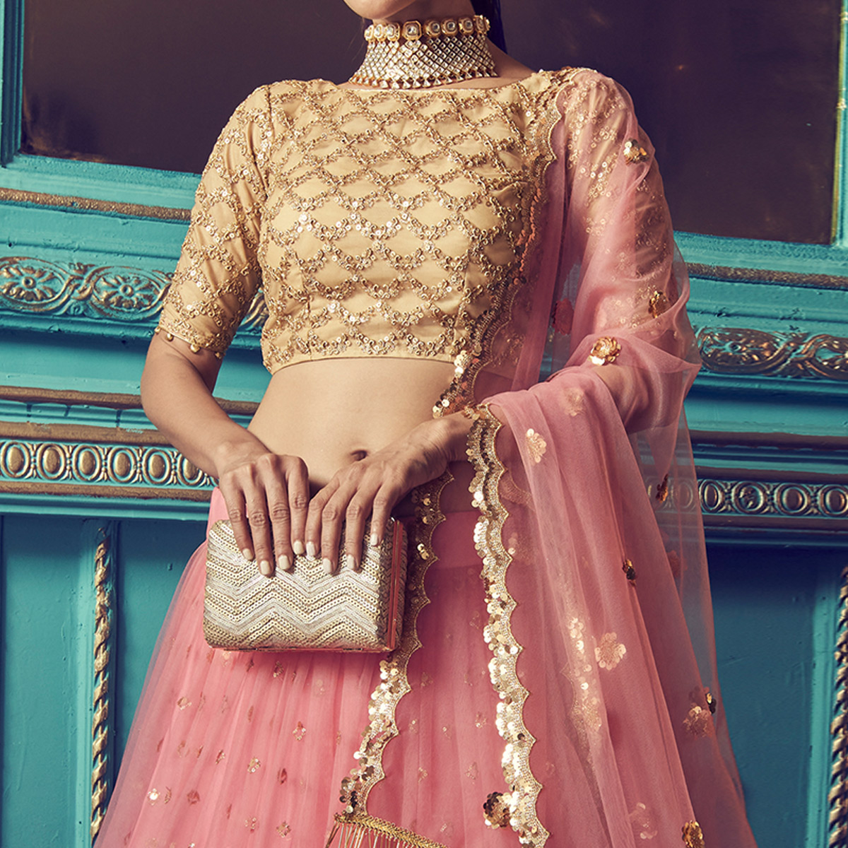Surpassing Pink Colored Partywear Embroidered Soft Net Lehenga Choli