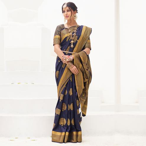 Exclusive Navy Blue Colored Festive Wear Woven Silk Saree With Tassels