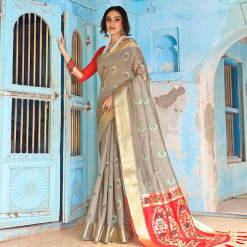 Flattering Grey Colored Festive Wear Woven Silk Saree With Tassels