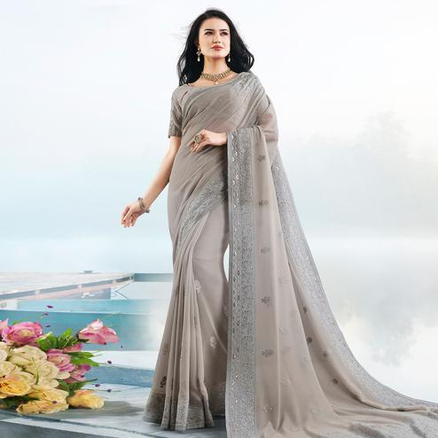 Flattering Grey Colored Partywear Embroidered Georgette Saree