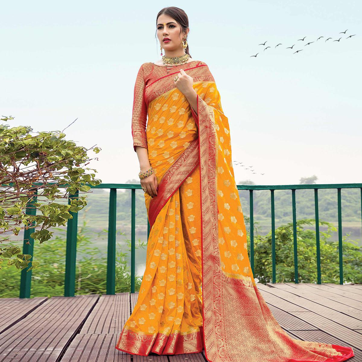 Staring Mustard Yellow Colored Festive Wear Woven Nylon Silk Saree