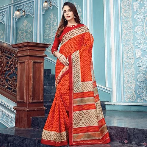 Eye-catching Orange Colored Partywear Printed Kota Silk Saree