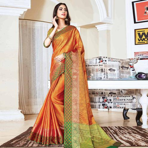 Exotic Orange Colored Festive Wear Woven Handloom Silk Saree
