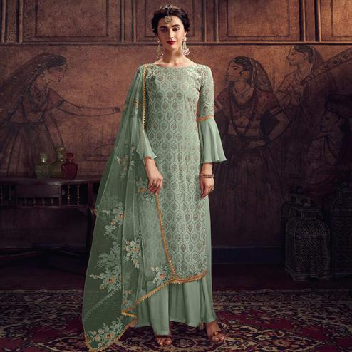 Glowing Green Colored Partywear Embroidered Rangoli Georgette Palazzo Suit