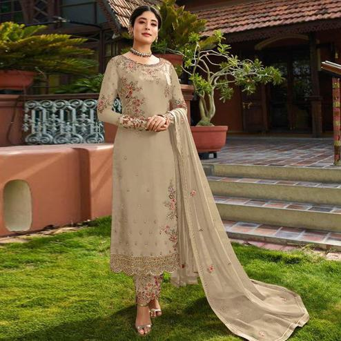 Demanding Beige Colored Partywear Embroidered Gerorgette Straight Suit