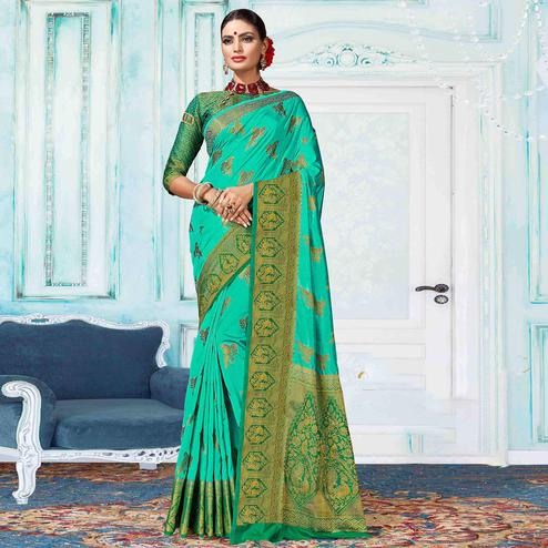 Dazzling Turquoise Green Colored Festive Wear Woven Nylon Silk Saree