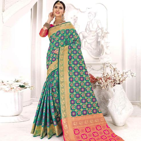 Intricate Turquoise Green Colored Festive Wear Woven Patola Silk Saree