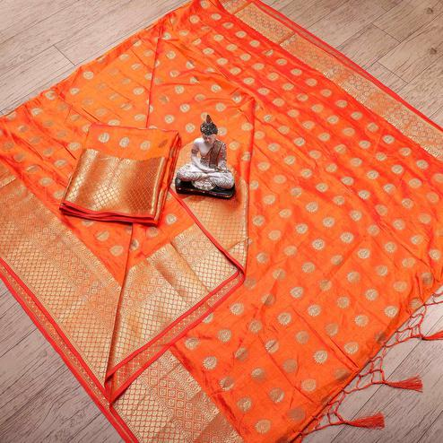 Ravishing Orange Colored Festive Wear Woven Banarasi Silk Saree With Tassels
