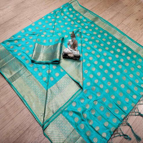 Staring Turquoise Blue Colored Festive Wear Woven Banarasi Silk Saree With Tassels