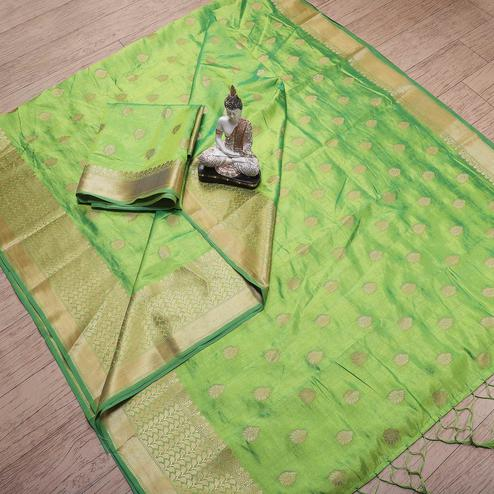 Dazzling Green Colored Festive Wear Woven Banarasi Silk Saree With Tassels