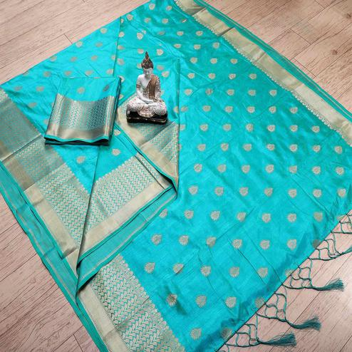 Arresting Turquoise Blue Colored Festive Wear Woven Banarasi Silk Saree With Tassels
