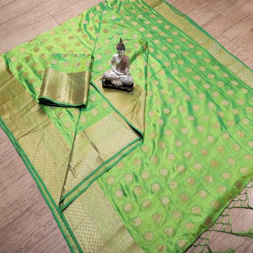 Desirable Green Colored Festive Wear Woven Banarasi Silk Saree With Tassels