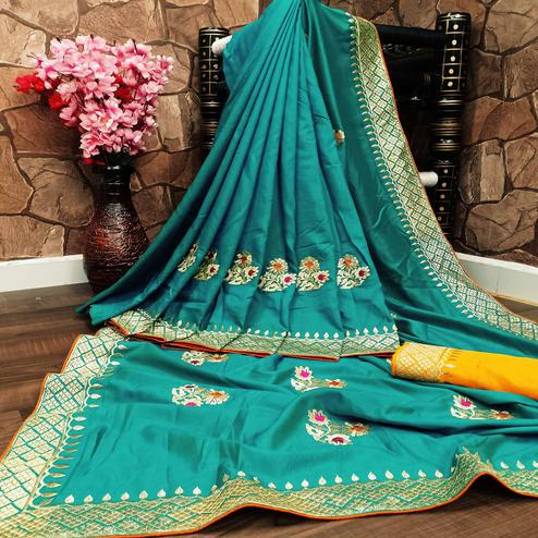 Charming Turquoise Colored Festive Wear Woven Dola Silk Saree