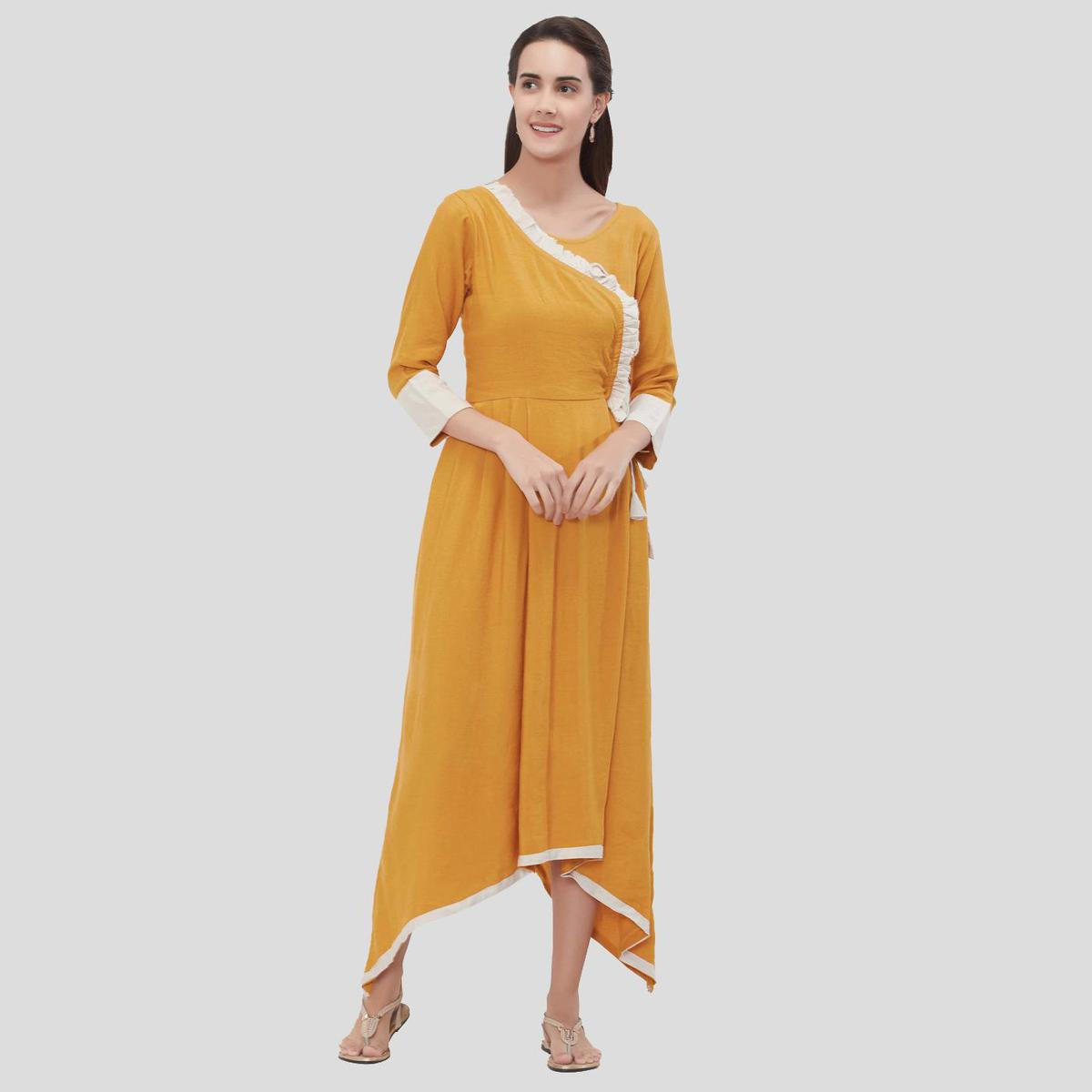 Mesmeric Yellow-White Colored Casual Wear Solid High To Low Rayon Flex Kurti