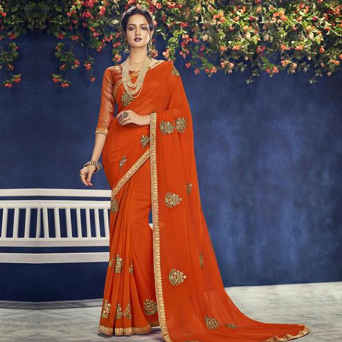 Indian Women Orange Colored Party Wear Embroidered Chiffon Saree