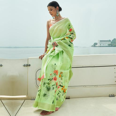 Energetic Green Colored Party Wear Floral Printed Linen Saree