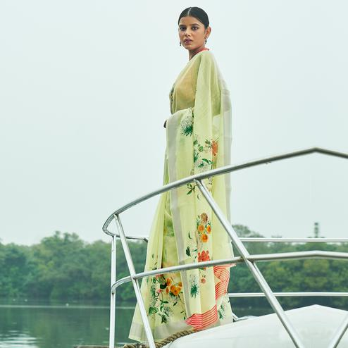 Glowing Pista Green Colored Party Wear Floral Printed Linen Saree