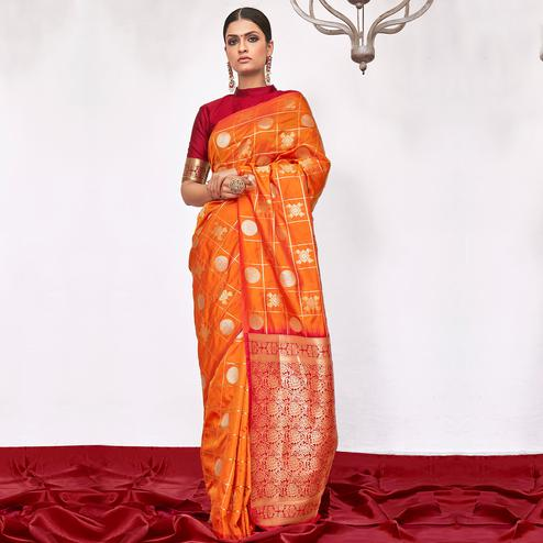 Entrancing Orange Colored Festive Wear Woven Silk Saree