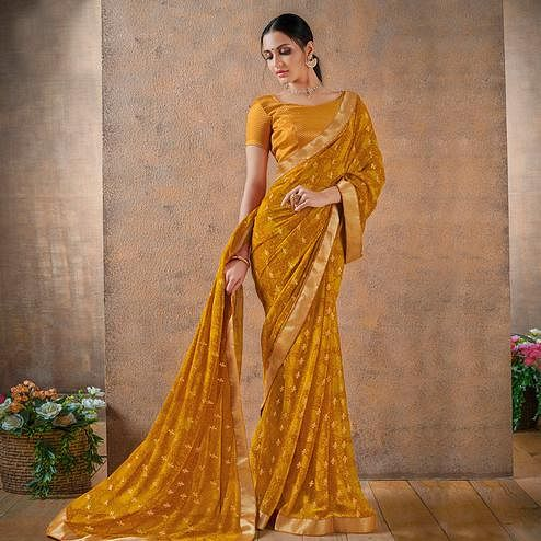 Glorious Mustard Yellow Colored Festive Wear Foil Printed Georgette Saree